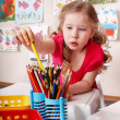 Child with colour pencil in preschool. — Stock Photo