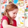 Stock Photo: Child playing with clay in play room.