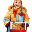 Child holding sleigh on white. - Stock Photo