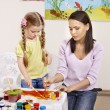 Child painting in preschool. - Stok fotoraf
