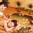 Woman getting massage in bamboo spa. — Foto de Stock