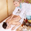 Stock Photo: Young woman on massage table in beauty spa.