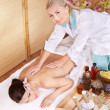 Young woman on massage table in beauty spa. — Stock Photo #7259465