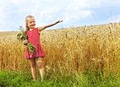Kid in wheat field. — Stock Photo