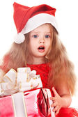 Child l in red dress with gift box. — Stock Photo