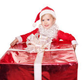 Child in santa hat giving gift box. — Stock Photo