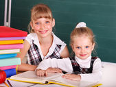 Schoolchildren in classroom near blackboard. — Stock Photo