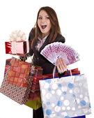 Obchodní žena s penězi, dar, krabice a tašky. — Stock fotografie