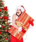 Christmas girl in santa holding gift box. — Stock Photo