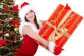 Christmas girl and fir tree with red gift box. — Stock Photo