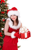 Christmas girl in santa hat with small red gift box,snow. — Stock Photo