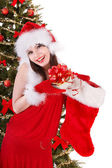 Girl in santa holding christmas socks and gift box. — Stock Photo