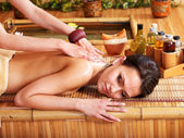 Woman getting massage in bamboo spa. — Стоковое фото