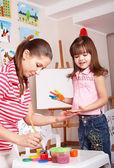 Child preschooler with handprints. — Stock Photo