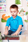 Child mould from clay in play room. — Stock Photo
