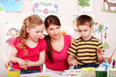 Group child and teacher mould from clay in play room. — Stock Photo
