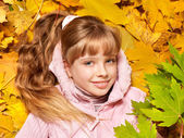 Kid in autumn orange leaves. — Stock Photo