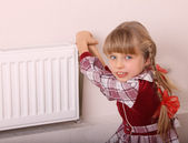 Girl try open thermostat. Crisis. — Stock Photo