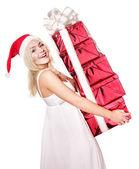 Christmas girl in santa hat holding red gift box. — Stock Photo