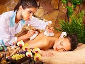 Woman getting thai herbal compress massage . — Stock Photo