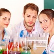Group chemistry student with flask. — Stock Photo #7559969