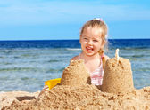 Kid playing on beach. — Stock Photo
