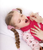 Doctor exams child with sore throat. — Stock Photo