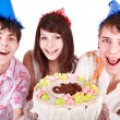 Group in party hat eat cake. — Stock Photo