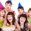 Group of happy young with cake. — Stock Photo #7609981