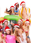 Group holding beach accessories. — Stock Photo