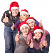 Group young in santa hat show thumbs up. — Stock Photo