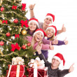 Group of young in santa hat show thumb. — Stock Photo