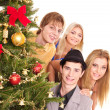 Group by christmas tree. — Stock Photo #7610114