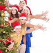 Group young by christmas tree. — Stock fotografie #7610128