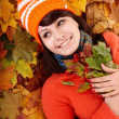 Girl in autumn orange leaves. — Stock Photo