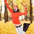 Girl with autumn leaf jump outdoor. — Stock Photo