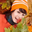 Young woman in autumn orange leaves. — Stock Photo #7610192