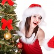 Girl in santa hat are showing thumb. — Stock Photo
