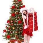 Christmas girl in santa holding stack gift box. — Stock Photo