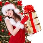 Christmas girl in santa holding stack gift box. — Stock Photo #7610216