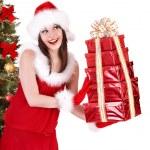 Christmas girl in santa hat holding stack gift box. — Stock Photo #7610219