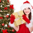 Girl in santa hat holding  gift box. — Foto Stock