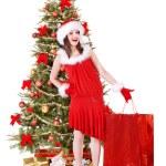 Christmas girl in santa hat giving gift box. — Stock Photo #7610253