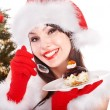Christmas girl in santa hat eat cake on plate. — Foto Stock #7610259