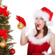 Christmas girl in santa hat with fir tree. — 图库照片