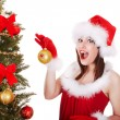 Christmas girl in santa hat with fir tree. — Stockfoto