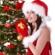 Christmas girl in santa hat with fir tree. - 图库照片