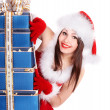 Christmas girl in santa hat holding stack gift box. — Stock Photo #7610300