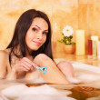 Woman shaving her legs — Stock Photo #7610491