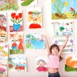 Child in art class with picture. — Stock Photo #7610782